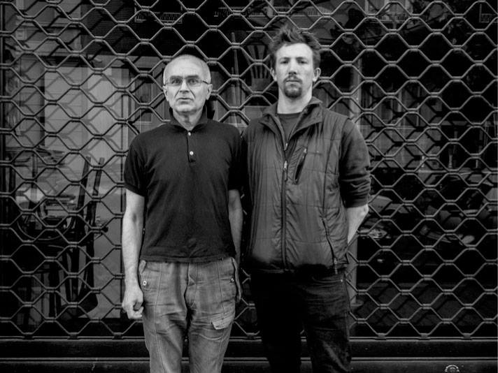 Andrei Mironov (left) and Italian photojournalist Andy Rochelli were killed near Slaviansk when they were struck by mortars likely fired by Ukrainian Army troops who were stationed atop a high hill overlooking a bridge and the road.