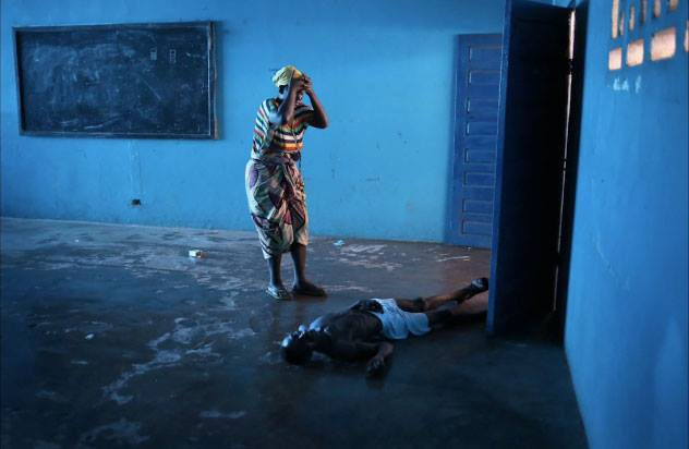 """Getty Images photojournalist John Moore has won Picture of the Year in the 11th annual China International Press Photo Contest (CHIPP) contest for his image, """"Ebola Overwhelms Liberian Capital."""""""
