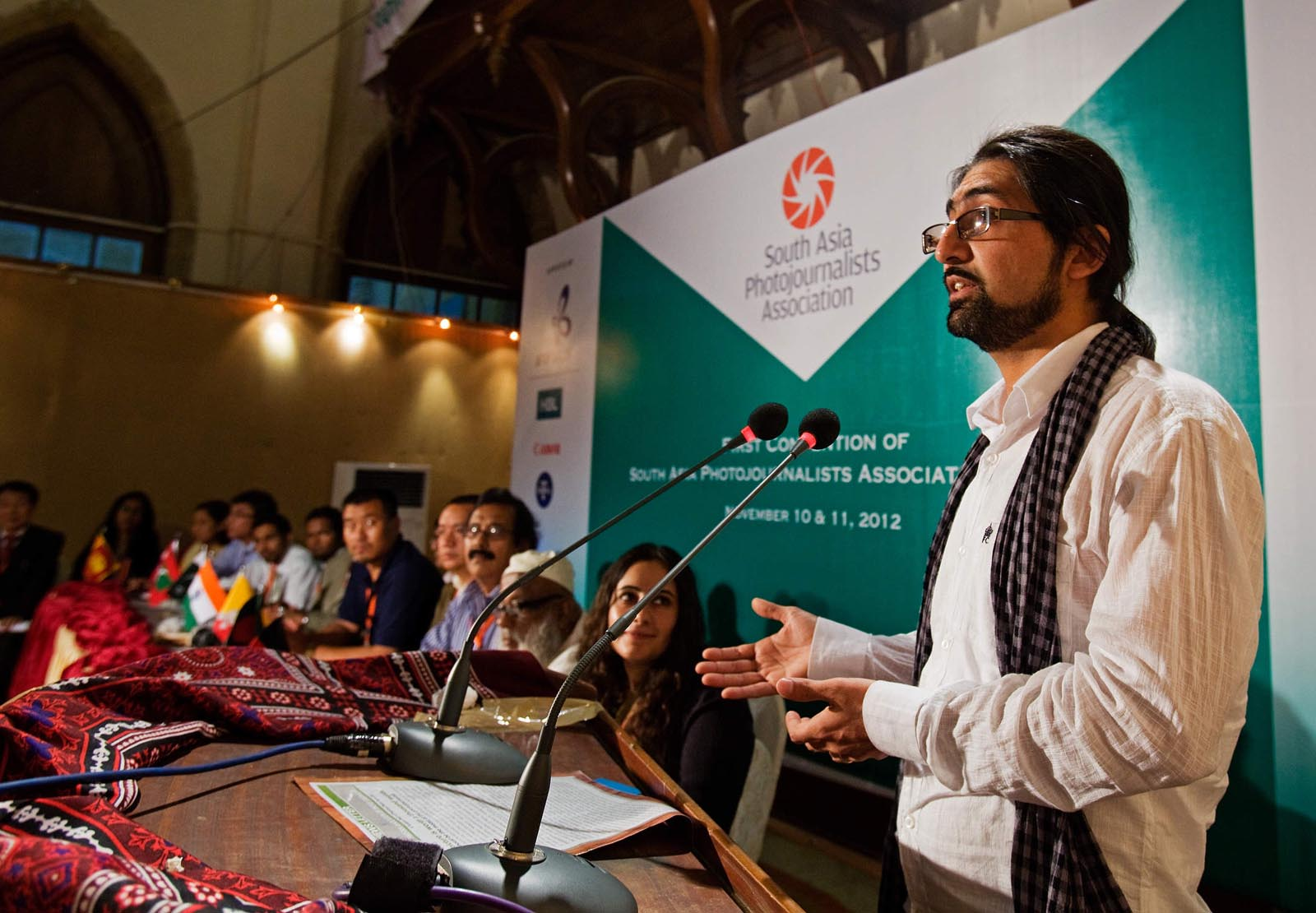 Photojournalist Massoud Hossaini addressed the South Asia Photojournalism Association convention after signing the founding constitution in Karachi, Pakistan on November 11, 2012. Hossaini is SAPA's first president. Photograph by Max Becherer-Polaris Images