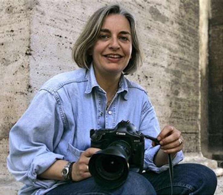 In this April 2005 file photo, Associated Press photographer Anja Niedringhaus poses for a photograph in Rome. Niedringhaus, 48, was killed and an AP reporter was wounded on Friday when an Afghan policeman opened fire while they were sitting in their car in eastern Afghanistan. Niedringhaus an internationally acclaimed German photographer, was killed instantly, according to an AP Television freelancer who witnessed the shooting. Kathy Gannon, the reporter, was wounded twice and is receiving medical attentio