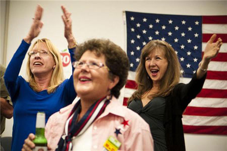 Christine Fidler (from left), Rena Pezzuto and Vera Dragicevich celebrate after the announcement was made that President Barack Obama had won the presidential election at the Ventura County Democratic Party Headquarters in Camarillo, CA. Photograph by John Rose, Brooks