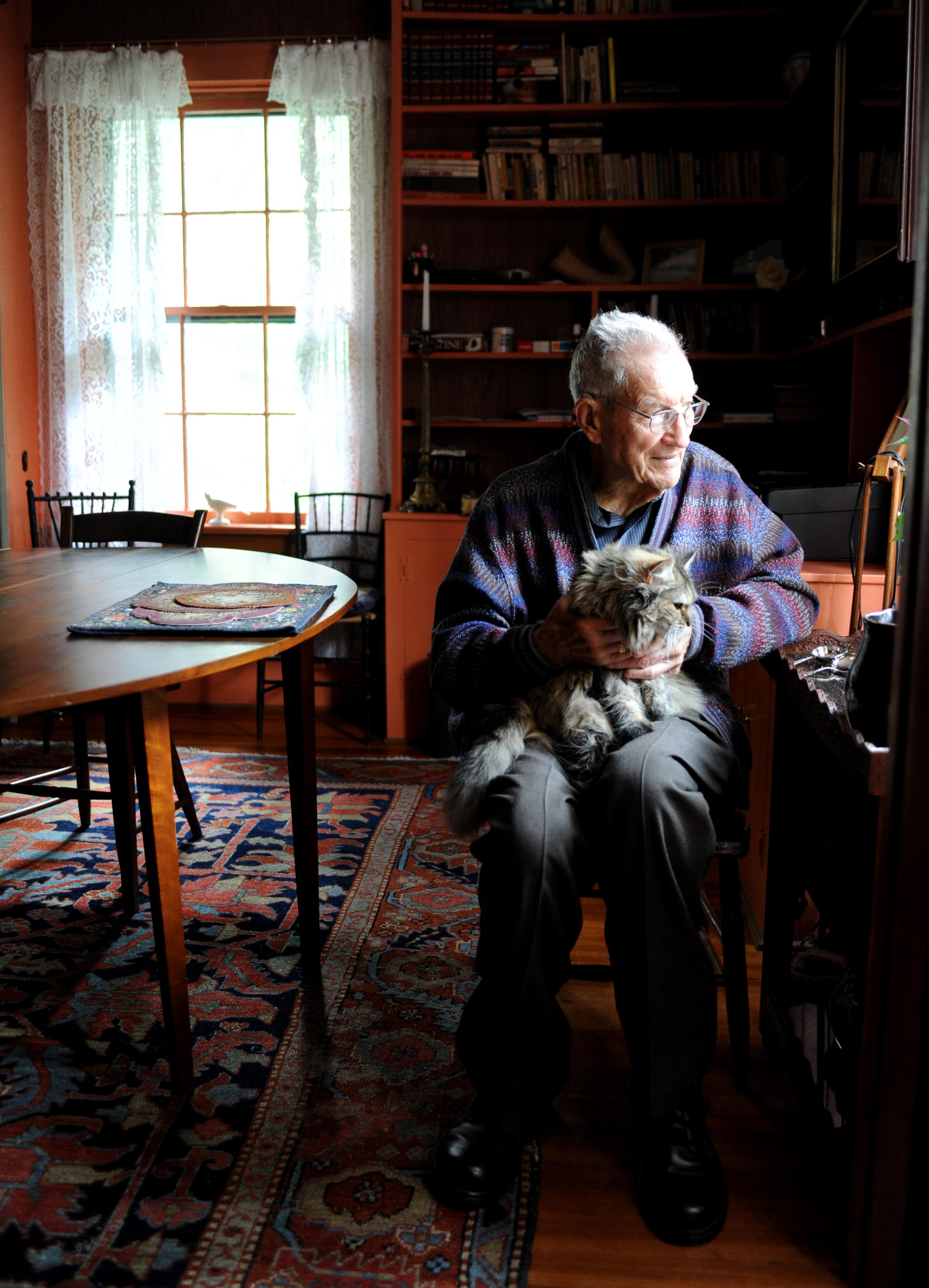 Robert E. Gilka and his cat at his home in Arlington, VA, in 2010. Photographs by J. Bruce Baumann