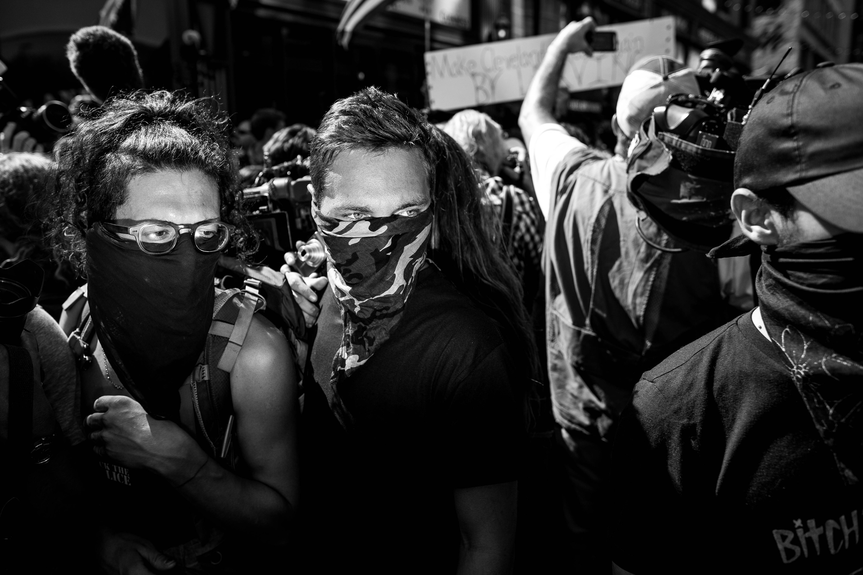 Protesters, identifying themselves as anarchists, gather amid media and police during a demonstration near the Republican National Convention July 20, 2016 in Cleveland, Ohio.