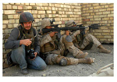 Photojournalist Ashley Gilbertson, seen with two Marines as they pushed through to take control of an insurgent stronghold in Fallujah. Photograph by Dexter Filkins