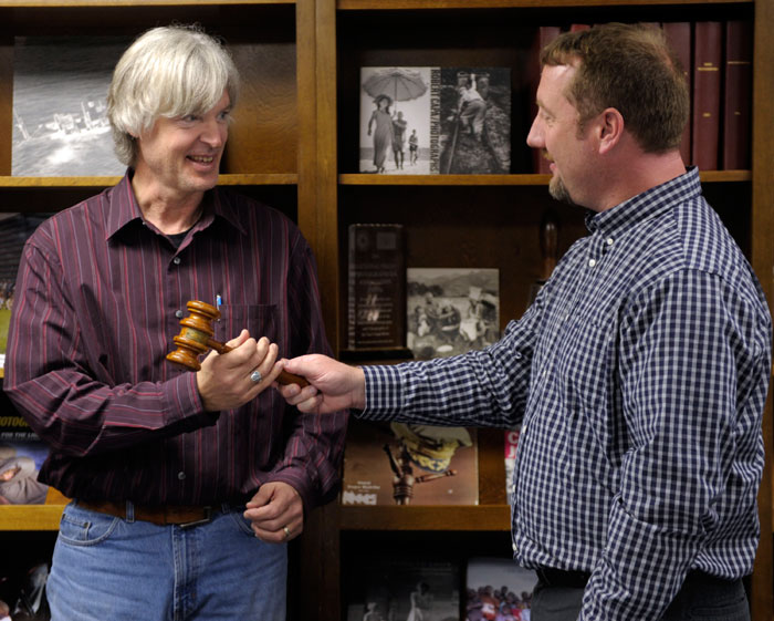 Michael Borland of WHO-TV (left) was given the NPPA gavel by outgoing president Sean D. Elliot