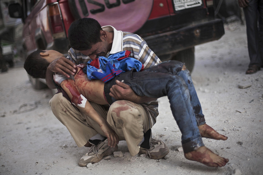 A Syrian man cries while holding the body of his son near Dar El Shifa hospital in Aleppo, Syria, October 3, 2012. The boy was killed by the Syrian army. This photograph by Associated Press photographer Manu Brabo is one of 20 in the group portfolio submitted by The Associated Press which won a Pulitzer Prize for Breaking News photography today.