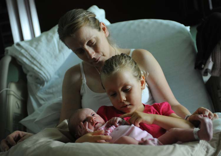Amy Beth Bennett, Sophia, 3, along with her newborn sister, Sienna Grace. Photograph by Joe Cavaretta