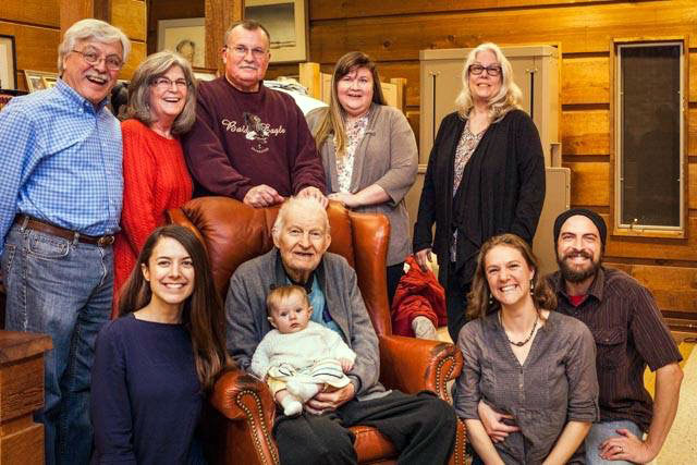 Chuck Scott, the center of a large four-generation family at Thanksgiving in 2014, along with Christina Baird, Stone Jane Eiler, Addie Helmke, Andrew Ocean Eiler, Terry Eiler, Lyntha Scott Eiler, Tom Scott, Natalie Scott Esky, and Kathie Reed Scott. Photograph courtesy of Terry Eiler