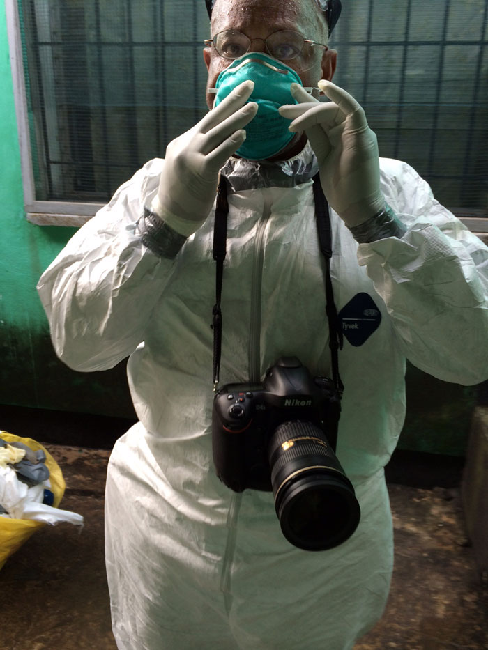 Washington Post photojournalist Michel du Cille, seen while on assignment covering the Ebola crisis in Liberia. Du Cille has been back in the States for 21 days now and has been following the Centers for Disease Control criteria for monitoring his health. He is symptom free.