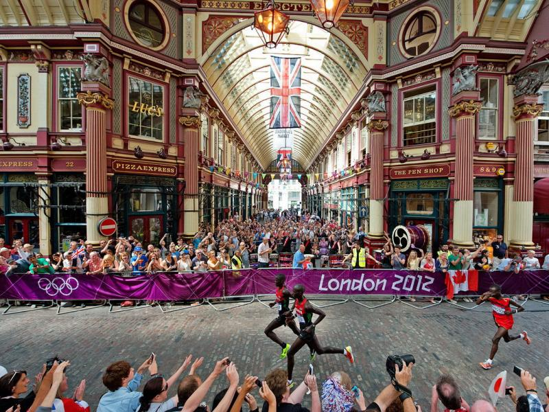 2012 London Olympic Games: Abel Kirui of Kenya, Wilson Kipsang Kiprotich of Kenya and Stephen Kiprotich of Uganda run through Leadenhall Market as they compete in the Men's Marathon. Photo by Mike Powell