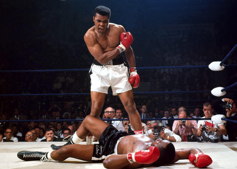 May 25, 1965, Ali stops Sonny Liston with one punch in the first round of their heavyweight championship fight in Lewiston, Maine. Photo by Neil Leifer