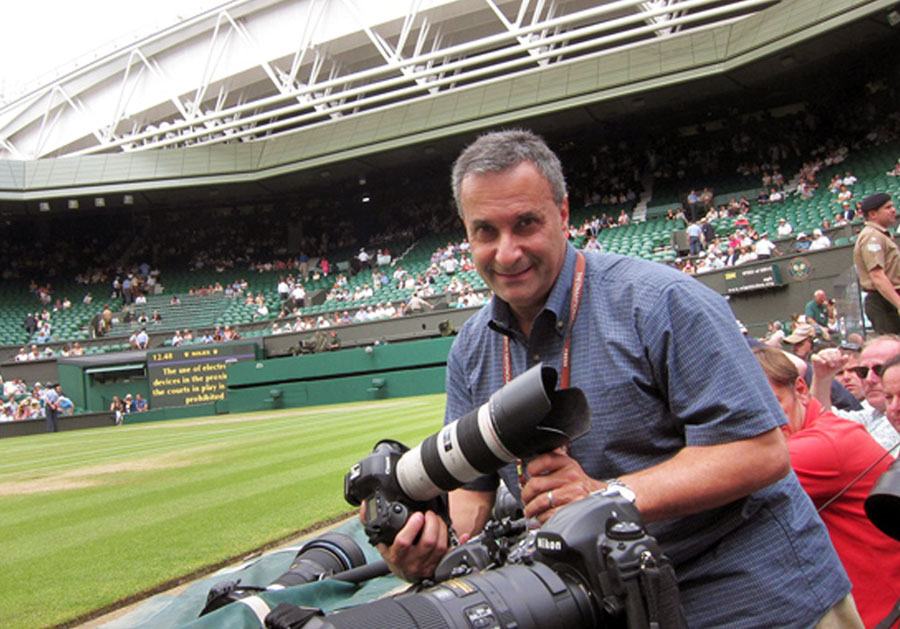 Reuters global sports picture editor Gary Hershorn, seen on the sidelines of the famed center court at Wimbledon.