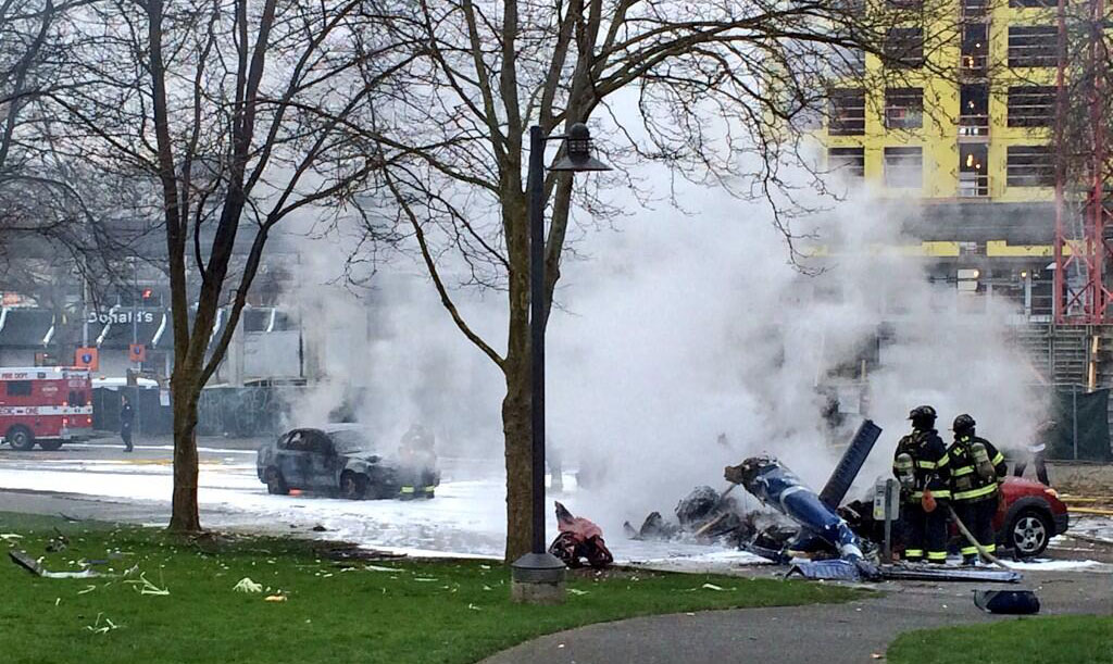 Firefighters arrived on the scene of the KOMO-TV helicopter crash outside Fisher Plaza in Seattle this morning. Photograph by Brian Rosenthal - The Seattle Times (Below, see addition photographs)