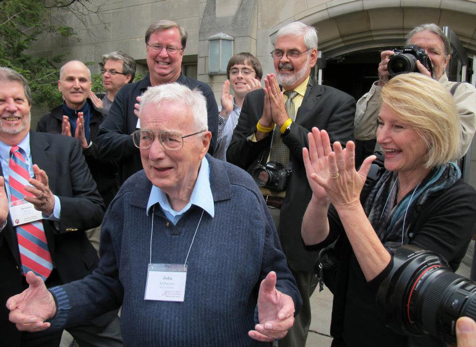 Surrounded by his loving former students, John Ahlhauser enjoyed their applause during an Indiana University photojournalism reunion that coincided with the journalism school's 100th anniversary.