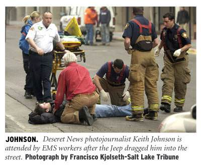 [Johnson: Deseret News photojournalist Keith Johnson is attended by EMS workers after the Jeep dragged him into the street. Photograph by Francisco Kjolseth - Salt Lake Tribune]