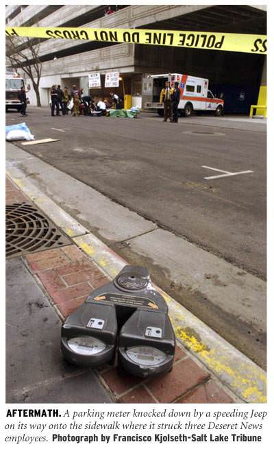 [Aftermath: A parking meter knocked down by a speeding Jeep on its way onto the sidewalk where it struck three Deseret News employees. Photograph by Francisco Kjolseth - Salt Lake Tribune]