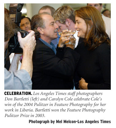[Celebration: Los Angeles Times staff photographers Don Barletti (left) and Carolyn Cole celebrate Col's win of the 2004 Pulitzer in feature photography for her work in Liberia. Barletti won the Feature Photography Pulitzer Prize in 2003. Photograph by Mel Melcon/Los Angeles Times]