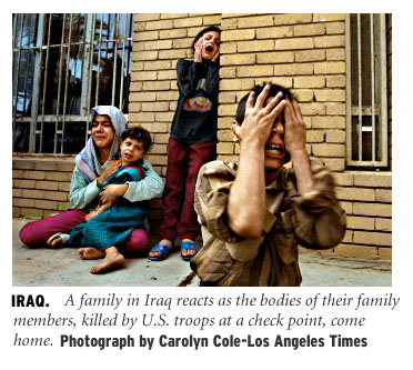 [Iraq: A family in Iraq reacts as the bodies of their family members, killed by US troops at a check point, come home. Photograph by Carolyn Cole/Los Angeles Times]