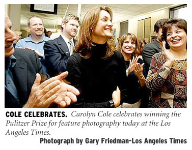 [Cole Celebrates: Carolyn Cole celebrateswinning the Pulitzer Prize for feature photography today at the Los Angeles Times. Photograph by Gary Friedman/Los Angeles Times]