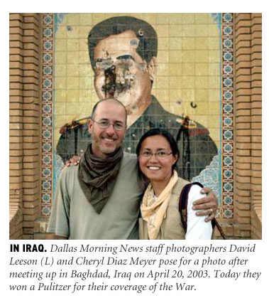 [In Iraq: Dallas Morning News staff photographers David Leeson (L) and Cheryl Diaz Meyer pose for a photo after meeting up in Baghdad, Iraq on April 20, 2003. Today they won a Pulitzer for their coverage of the war.]