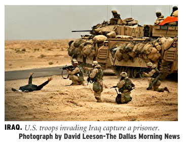 [Iraq: US Troops invading Iraq capture a prisoner. Photograph by David Leeson/The Dallas Morning News]