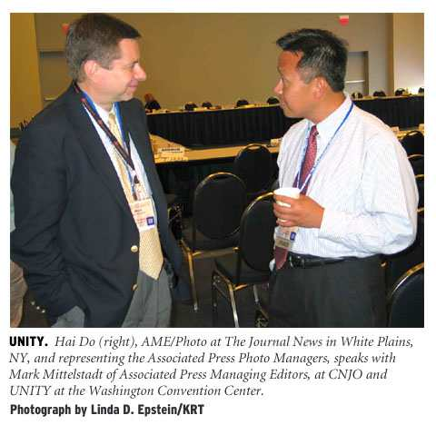 [Unity: Hai Do (right), AME/Photo at The Journal News in White Plains, NY, and representing the Associated Press Photo Managers, speaks with Mark Mittelstadt of the Associated Press Managing Editors, at CNJO and UNITY at the Washington Convention Center. Photograph by Linda D. Epstein/KRT.]