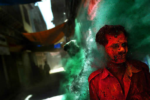 Photo by David Guttenfelder of people in the old city of Delhi celebrating Holi, the Hindu festival of colors.