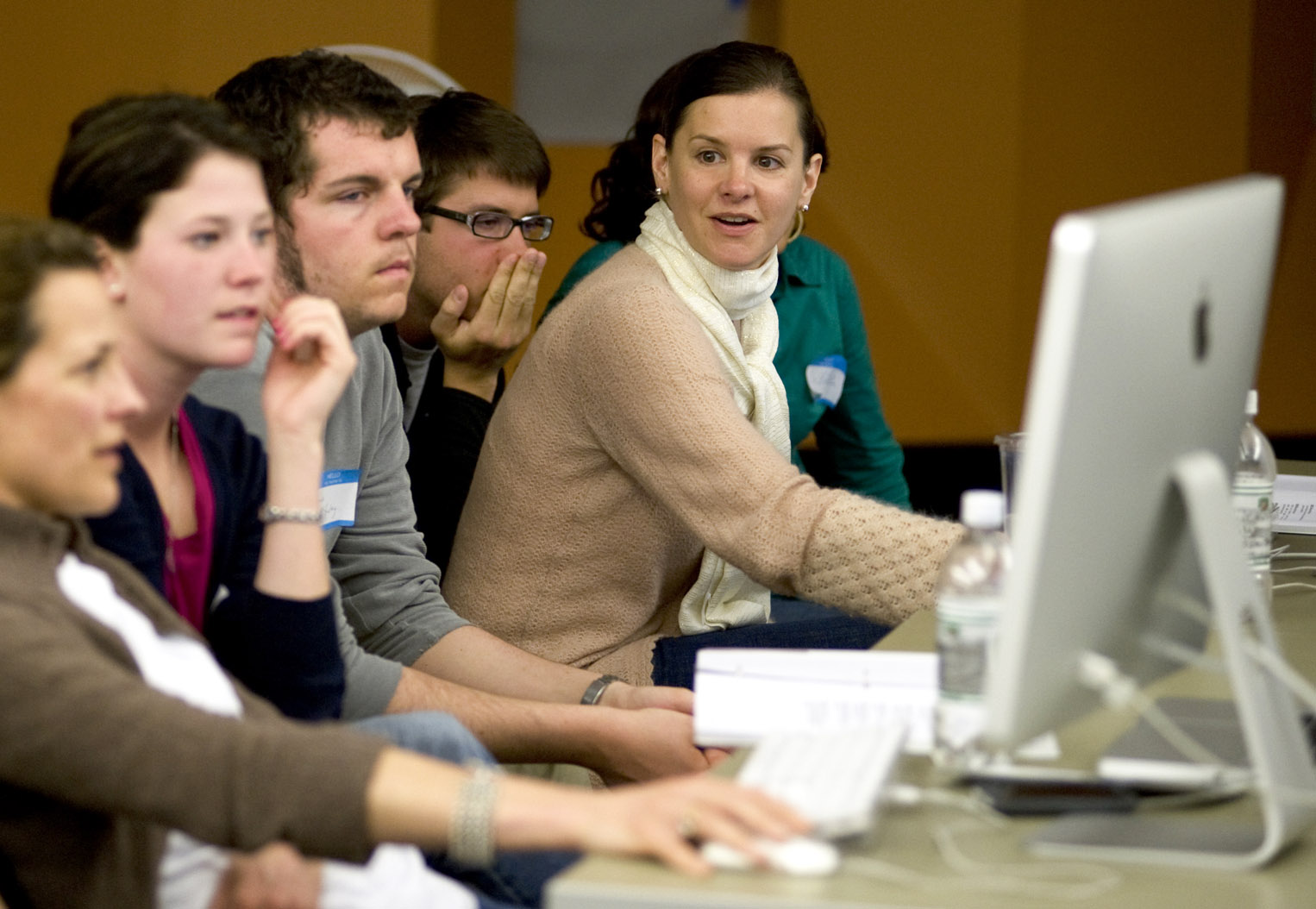 Jennifer Poggi (right, in scarf) with Ohio University students during NPPA's Best Of Photojournalism judging in 2009. Photograph by Jennifer Cecil