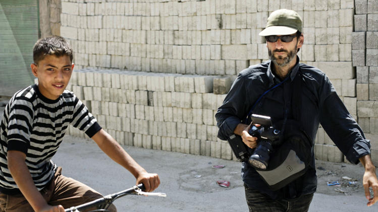 This undated photograph released by the family of Ricardo Garcia-Vilanova last year shows Spanish photojournalist Ricardo Garcia-Vilanova as he walked alongside a Syrian boy who was riding a bicycle in Aleppo, Syria.