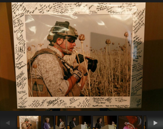 A photograph of David Gilkey, the frame signed by family and friends, at Friday's memorial service in Portland, OR. Photograph by John Rudoff