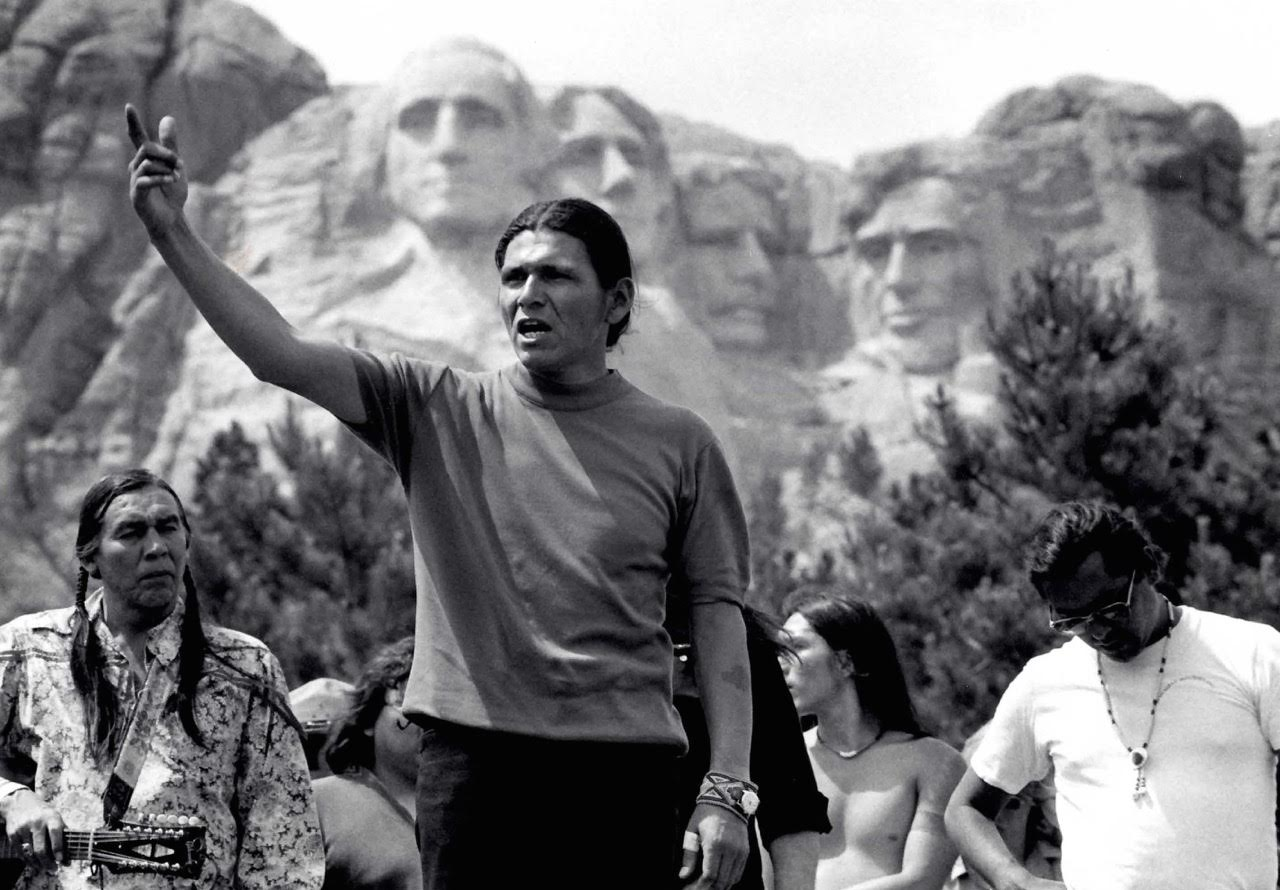 Native American Dennis Banks, co-founder of the American Indian Movement at Mt. Rushmore. Photo © 1974 Rick Smolan