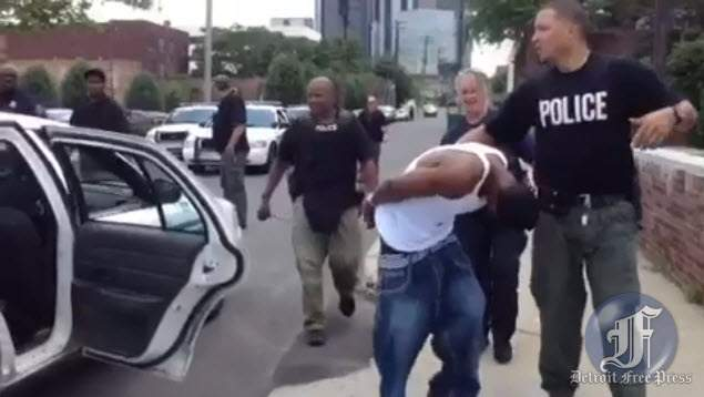 Image from Detroit Free Press reporter Mandi Wright's video before her arrest.